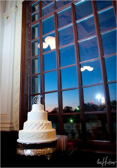 White cake with initial topper - Photo by Jason