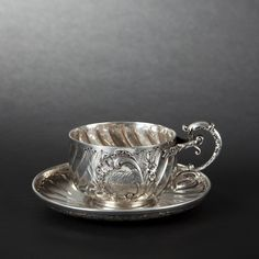 Silver cup and saucer, 19th Century