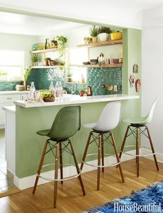 colorplay of the green tones in tile, wall, stools - kitchen breakfast counter