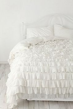 I love the 'Waterfall Ruffle Duvet' bed set from Urban Outfitters. It's so lovely.