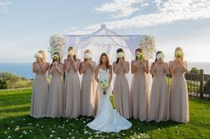 Nude bridesmaid dresses and a beautiful backdrop: http://www.stylemepretty.com/california-weddings/los-angeles/2014/12/05/jen-bunneys-elegant-la-wedding/ | Photography: Lin & Jirsa - http://www.linandjirsa.com/