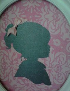 ribbon bow on silhouettes and scrapbook paper..For Kaya's room! Even has her signature bow