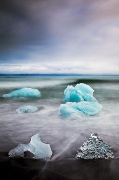 Ice Deposits Waves move around chunks of ice on the volcanic beach in front of Jokulsarlon - Iceland's famous Ice Lagoon. Tours In Iceland, Iceland Travel, Travel Around The World, Around The Worlds, Native Country, Natural Phenomena, Natural Wonders, Ecology, Great Photos
