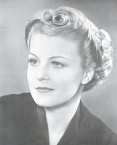 30's - she looks like my mom when she was younger, but this was waaaay before her time
