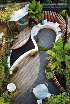 terrassengestaltung-grünanlagen-sitzecke-hol-und-steinbelag