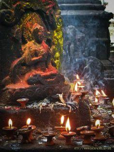 Candlelight for the gods. Kathmandu, Nepal.