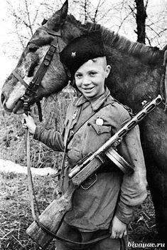 Young Soviet Cossack with a submachine gun PPSh 41 / Юный советский казак с пистолетом-пулеметом ППШ 41