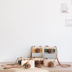 Fanny and Alexander wooden camera with zoom and leather grip shop here: https://teaandkate.co.uk/products/fanny-and-alexander-wooden-camera-with-zoom-and-caramel-leather-grip-1?variant=15528065926