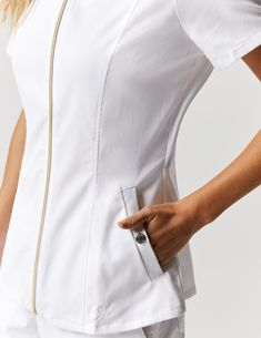 Biker Top in White is a contemporary addition to women's medical scrub outfits. Shop Jaanuu for scrubs, lab coats and other medical apparel. Scrubs Outfit, Lab Coats, Medical Scrubs, Scrub Tops, Welt Pocket, Chef Jackets, Biker, Peplum, Shopping