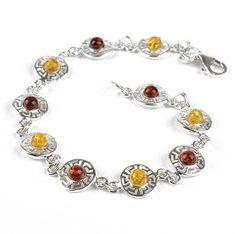 """""""Celtic Amber Circles Bracelet Item No. AM02004A01 $48.29 This Celtic circles bracelet was made in Russia with ten authentic Baltic amber stones in varying colors, surrounded with sterling .925 silver stylized in a Celtic design. This 3/8"""" wide bracelet is lightweight and elegant. Size 7 wrists are ideal for this 7 1/4"""" long bracelet."""" Celtic Circle, Amber Stone, Celtic Designs, Amber Jewelry, Baltic Amber, Circles, 925 Silver, Elegant, Russia"""
