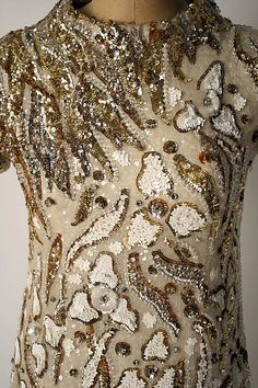 Detail of the embroidery on a Valentino evening dress of ca.1969.