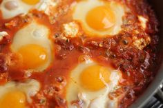 A delicious dish made with eggs cooked in a spicy tomato sauce. Comforting and wonderful, it goes well with crusty bread! This is the best recipe ever. Egg Recipes, Great Recipes, Cooking Recipes, Favorite Recipes, Recipies, Yummy Recipes, Healthy Recipes, Shakshuka Recipes, Huevos Fritos