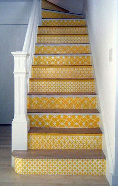 I wouldn't do yellow, but I Love this idea to liven up a staircase!