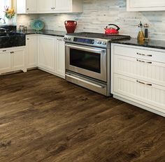 Updated your American Kitchen with CAROLINA HICKORY. One of our beautiful all American made floors in our new Moduleo Vision LVT collection.