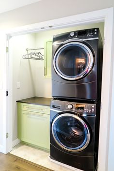 This downstairs laundry room with stacked washer & dryer can be accessed near the kitchen