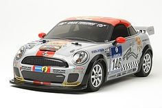 The Tamiya R/C MINI JCW Coupe - Model Kit in 1/10 scale is a radio control car from the Tamiya rc road collection.  This is an RC replica of the MINI JCW Coupe race car, which raced in the SP 3T class at the 39th ADAC Zurich 24 Hours of Nurburgring 2011. This car was based on the new 2-seater MINI Coupe and features race specifications including a sharper windshield angle, adjustable suspension and rear wing and a 247hp 1.6l 4-cylinder twin-scroll turbo engine that gives a top speed of…