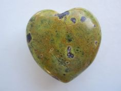 Atlantisite is a hard stone to find. It is what I consider a stone for the New Age. It is serpentine mixed with stichtite. Atlantisite is an outstanding stone for meditation enabling you to both access and retrieve ancient wisdom and information about past lives. In particular, it can help us to access spiritual wisdom, skills and knowledge from past lives in Atlantis. It can even help bring to completion projects begun at that time. It can also help in raising your kundalini.This heart…