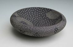Junko Kitamura.  Low, round, double-walled concave dish, decorated with knot-like punched-patterning accentuated with white slip inlays, 2013 Stoneware with ...
