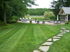 Rhino Lawn Services   Charlotte, NC Landscape and Lawn Service ...Well Maintained Lawn as Part of an Enviable Home Landscape/ Pool/ Stone Path