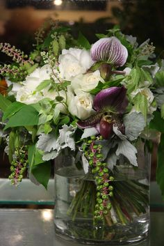 .flower arrangement with lady slipper orchids
