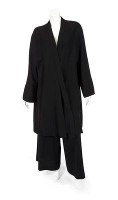 Jean Muir black wool coat and matching wide-leg trousers. Coat has tie closure.  FRAN DRESCHER JEAN MUIR ENSEMBLES - Price Estimate: $200 - $400