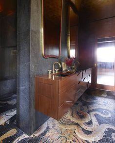 Master Bath of a Manhattan apartment designed by Jim Luigs - 1950s mirrors, Waterworks fittings, a mosaic tile floor by Sicis is based on a 1st-century Pompeian mosaic at the Museo Archeologico Nazionale in Naples