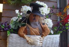 Half Scarecrow in a basket of Geraniums---can be purchased and shipped from the Old Mercantile in Clarksville Tn.-----theoldmercantile.com----Facebook----931-552-0910