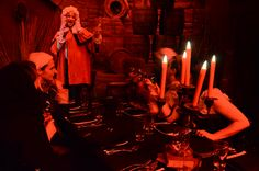 London Dungeon characters entertaining guests at dinner.