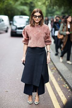 Navy structured skirt, with a peach fur jumper and printed heels | Image via bloglovin.com