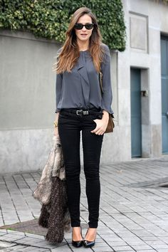 Every women should own a couple blouses. We love this combination of black, skinny jeans and a dusty gray blouse. Click here for other great business casual outfits.