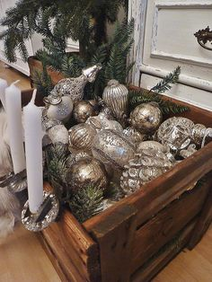 A crate full of pretty ornaments.  No candles.
