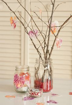 Make a valentine centerpiece with jars, twings and cut out hearts. easy and cute. Change the ornaments to fit any holiday too!