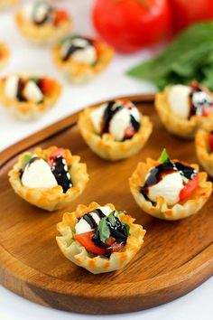 These Caprese Cups are a delicious bite-sized appetizer that will be the hit of your next party! Filled with cherry tomatoes, mozzarella cheese, fresh basil and a drizzle of balsamic glaze, these bites are easy to make and even better to eat! Cold Appetizers, Finger Food Appetizers, Appetizers For Party, Appetizer Recipes, Party Snacks, Simple Appetizers, Italian Appetizers, Gourmet Appetizers, Phyllo Recipes