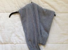 How to Hang a Sweater so the shoulders don't get stretched out.  This is brilliant, I just tried it and it totally works.  It looks like the sweater should slide right off, but it's very stable.