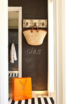 narrow chalk wall with hooks