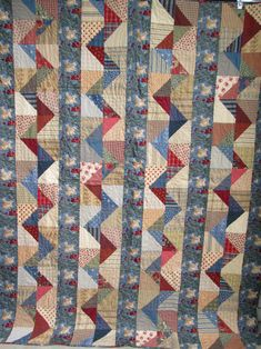 RMM Quilt:  Serpentine Scrap Quilt, uneven HST triangles from APQ Shop Sampler