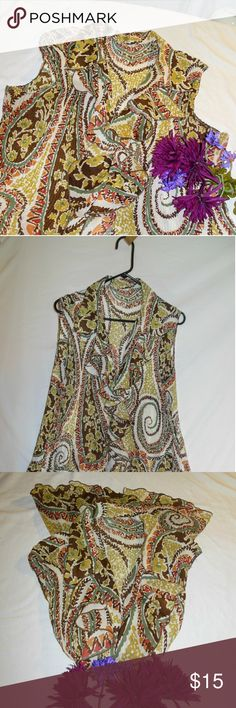 Earth Toned Spirals & Florals Tank Blouse Sz 2X Here I have a tagless gorgeous tank top style blouse. I don't know who it was made by nor what the size is. Is very lightweight, very flowy, and a bit sheer. EUC.  It is button down with ruffles along the button line. The colors are earthy in shades of green, orange, brown, cream, white, Etc. In my opinion this blouse will fit up to a 3X. Measurements are as follows: L= 30 in, B=42-52 in, W=40-45 in, and H=70 inches.  Objects photographed with…