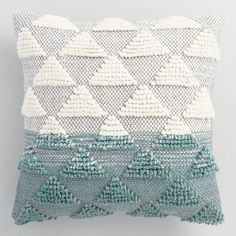 Our soft throw pillow features a silver-gray textured diamond design accented by cool jade ombre detail at one end.