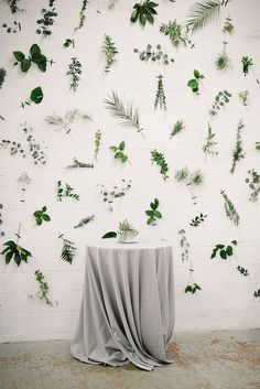 cocktail hour displays with a greenery leaf wall - photo by The Kama Photography http://ruffledblog.com/industrial-modern-wedding-with-a-greenery-wall