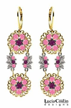 Dangle Flower Earrings by Lucia Costin Crafted in 14K Yellow Gold over .925 Sterling Silver with Violet, Pink Swarovski Crystals, Filigree Details and Sterling Silver Flower Center; Handmade in USA Lucia Costin. $87.00. Mesmerizing enough to wear on special occasions, but durable enough to be worn daily. Floral design accompanied by cute details. Unique jewelry handmade in USA. Lucia Costin flower shaped drop earrings. Embellished with purple and rose Swarovski crystals