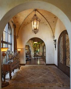 Tuscan home with groin-vault ceiling... Love this entrance