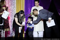 2012 - Musa picking our the Winner of our Floral Arrangement and Gift Certificate Winner on stage.