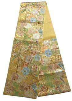 "This is an elegant Fukuro obi with 'Kiku'(chrysanthemum) and 'Sasa'(bamboo grass) pattern, which is woven with ""Fukure-ori"" which makes bumpy texture"