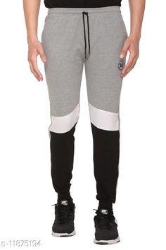 Track Pants Trendy Men Track Pants Fabric: Cotton Blend Pattern: Colorblocked Multipack: 1 Sizes:  34 (Waist Size: 34 in Length Size: 39 in)  36 (Waist Size: 36 in Length Size: 39 in)  38 (Waist Size: 38 in Length Size: 40 in)  28 (Waist Size: 28 in Length Size: 38 in)  40 (Waist Size: 40 in Length Size: 40 in)  30 (Waist Size: 30 in Length Size: 38 in)  42 (Waist Size: 42 in Length Size: 40 in)  32 (Waist Size: 32 in Length Size: 39 in) Country of Origin: India Sizes Available: 28, 30, 32, 34, 36, 38, 40, 42   Catalog Rating: ★4 (399)  Catalog Name: Fashionable Glamarous Men Track Pants CatalogID_2254994 C69-SC1214 Code: 462-11875194-645