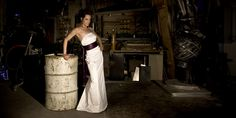 Maybe a little too industrial, but I like the contrast between the formal gown and the environment