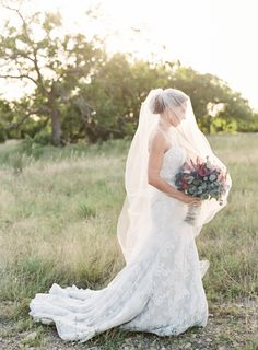 Strapless lace Matthew Christopher wedding gown: http://www.stylemepretty.com/texas-weddings/dripping-springs/2016/09/28/colorful-country-chic-summer-celebration-in-texas-hill-country/ Photography: Mint Photography - http://mymintphotography.com/