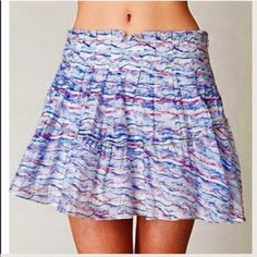 "📍Sale📍NWT Free People Multi Mini Skirt Size 28. NWT! ✨ Free People Fiesta Party Skirt.   Adorable printed mini skirt with exposed stitching and ruffled hem. Lined. Hidden side zipper.  THIS IS WAY MORE STUNNING THAN THE PHOTOS SHOW!!💎💎 *65% Rayon, 35% Nylon  *Machine Wash *Import  Length: 30"" Waist: 30 ½""- measured full circumference. Free People Skirts"