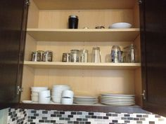 BEFORE: Main dish cabinet; plates and bowls, mismatched glassware and random bar stuff. #kitchncure