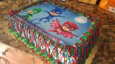 Pj masks bjrthday cake with transfer on top from etsy! Not bad for having to do it yourself.