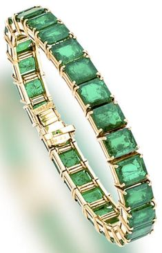 Emerald line bracelet, Harry Winston, 1985, composed of twenty-six graduated rectangular-cut cornered emeralds. total emerald weight: 38.21 carats